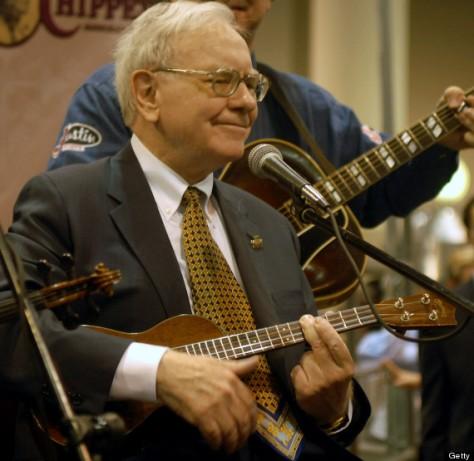 Berkshire Hathaway Inc. Chairman Warren Buffett plays with a